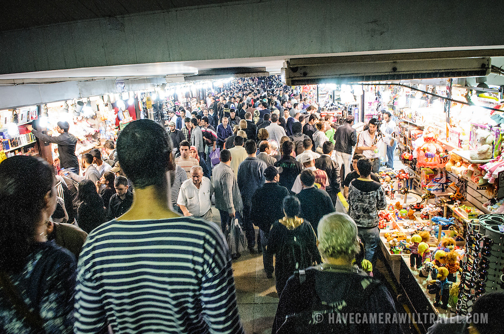 Crowds bustle in the underground walkway with shops at the Eminonu district on the Golden Horn waterfront in Istanbul.