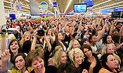 Fans react to the arrival of Twilight star Rachelle Lefevre, who plays the character Victoria, at the Walmart store in Riverton, Utah during the midnight DVD movie release event March 21, 2009. (AP Photo/Colin Braley)