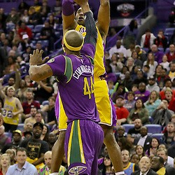 Feb 4, 2016; New Orleans, LA, USA; Los Angeles Lakers forward Kobe Bryant (24) shoots over New Orleans Pelicans forward Dante Cunningham (44) during the first quarter of a game at the Smoothie King Center. Mandatory Credit: Derick E. Hingle-USA TODAY Sports