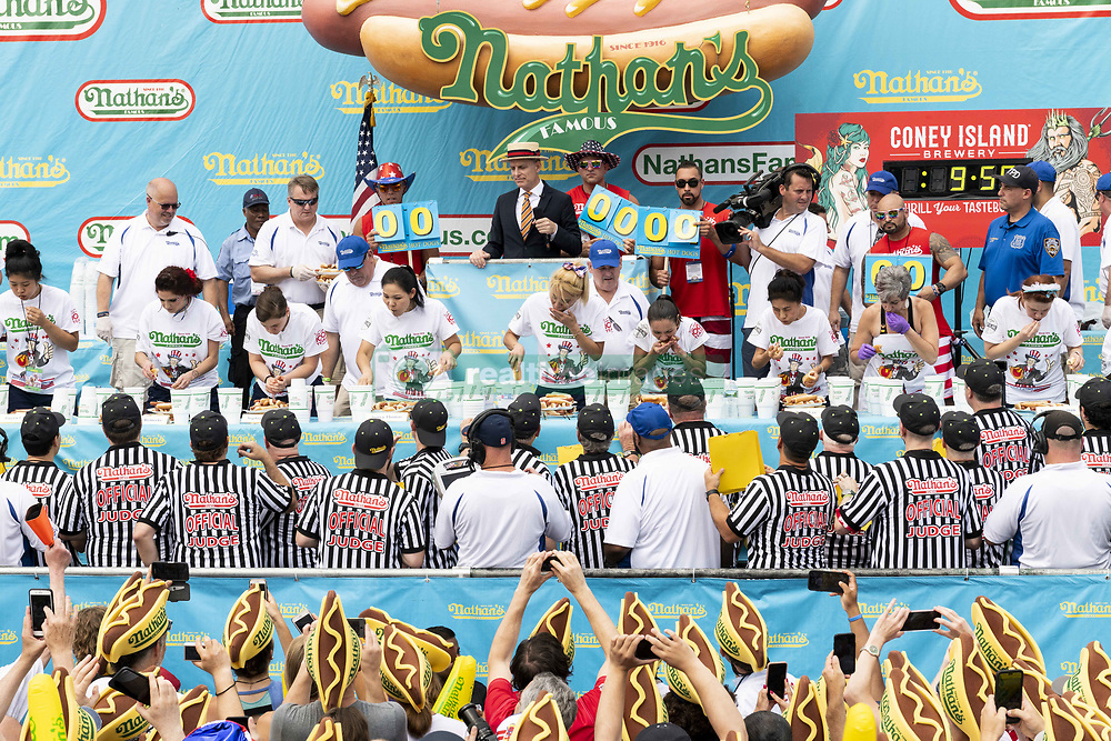 July 4, 2018 - Brooklyn, NY, U.S - MIKI SUDO (blonde hair, in the center) ate 37 hot  dogs and buns in ten minutes  to win the women's division of the 2018 Nathan's Famous International Hot Dog Eating Contest in Coney Island in Brooklyn, New York on July 4, 2018. (Credit Image: © Michael Brochstein via ZUMA Wire)