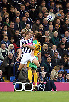 Photo: Mark Stephenson.<br /> West Bromwich Albion v Norwich City. Coca Cola Championship. 27/10/2007.Norwich's Darel Russell trys to win thje ball from Broms James Morrison