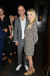 DINOS CHAPMAN and LUCY PUNCH at the West End opening night of 'Great Britain' a  play by Richard Bean held at The Theatre Royal, Haymarket, London followed by a post show party at Mint Leaf, Suffolk Place, London on 26th September 2014.
