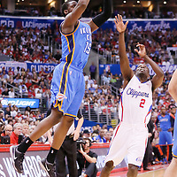 11 May 2014: Oklahoma City Thunder guard Reggie Jackson (15) takes a jump shot at the buzzer over Los Angeles Clippers guard Darren Collison (2) during the Los Angeles Clippers 101-99 victory over the Oklahoma City Thunder, during Game Four of the Western Conference Semifinals of the NBA Playoffs, at the Staples Center, Los Angeles, California, USA.