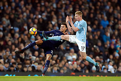Tottenham Hotspur's Dele Alli (left) and Manchester City's Kevin De Bruyne battle for the ball during the Premier League match at the Etihad Stadium, Manchester.