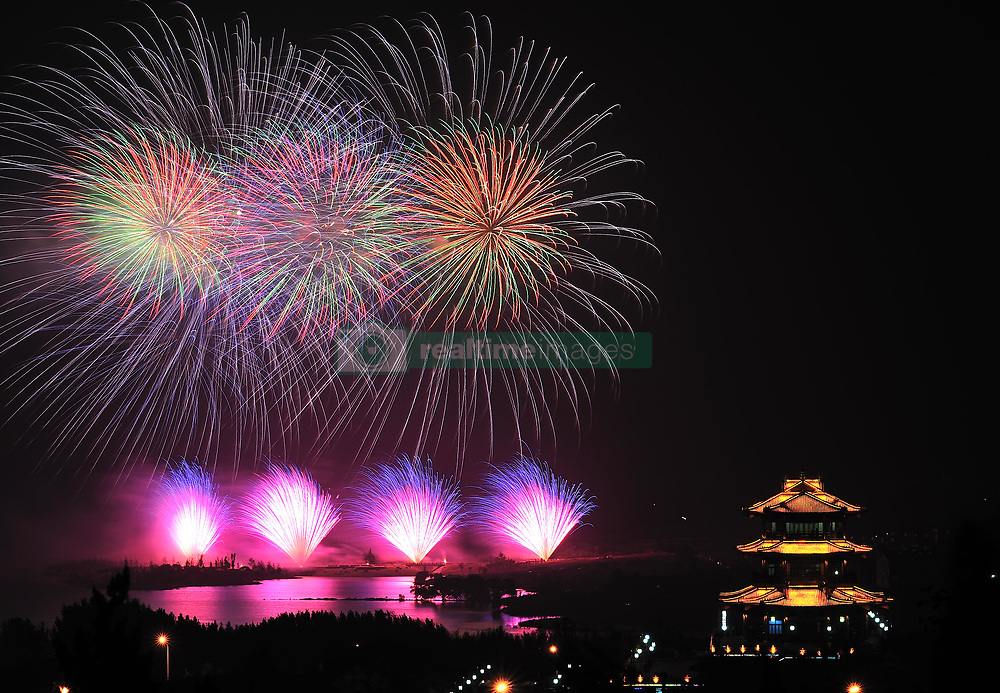 August 7, 2017 - Zhaoyuan, Zhaoyuan, China - Zhaoyuan, CHINA-August 7 2017: (EDITORIAL USE ONLY. CHINA OUT) ..Fireworks illuminate the sky over the Longhu Scenic Area in Zhaoyuan, east China's Shandong Province. (Credit Image: © SIPA Asia via ZUMA Wire)