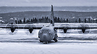 A Royal Canadian Air Force 436 Squadron CC-130J Hercules visits snowy Whitehorse, Yukon. When faced with drab and dreary, reinterpret in black and white!
