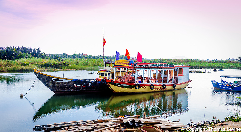 Boats on the Thu Bon River by Cam Kim.