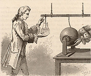 The origin of the Leyden Jar. Andreas Cuneus (1712-1778) Dutch lawyer and scientist, in the laboratory of Pieter von Musschenbroek (1692-1761),  attempting to electrify water contained in a bottle with the charge created by the friction from a glass globe static electric machine, Leyden, 1746.  Musschenbroek repeated the experiment and was surprised by the electric shock he received.  Engraving from 'Electricity in the Service of Man' by Amedee Guillemin (London, 1891).