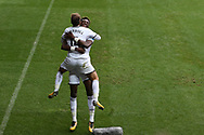 Tammy Abraham of Swansea city (r) celebrates with his teammate Tom Carroll after he scores his teams 1st goal. Premier league match, Swansea city v Huddersfield Town at the Liberty Stadium in Swansea, South Wales on Saturday 14th October 2017.<br /> pic by  Andrew Orchard, Andrew Orchard sports photography.
