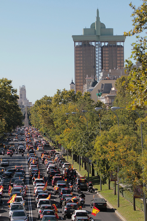MADRID, SPAIN - OCTOBER 12: Demonstrators waving Spanish flags participate in an in-vehicle protest against the Spanish government on Spain's National Day along Paseo de la Castellana during the second wave of Covid-19 pandemic on October 12, 2020 in Madrid, Spain. Far right-wing party Vox has called for their supporters to protest across Spain, against the Spanish government, after declaring the state of emergency in Madrid city to activate mobility restrictions to control the spread of Coronavirus disease. Madrid is at the moment the city worse hit in Europe by the Covid-19 pandemic (Photo by Miguel Pereira/Getty Images)