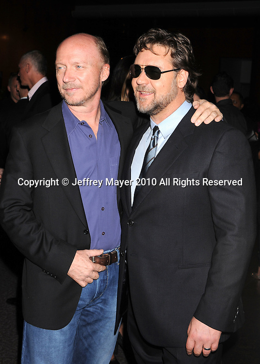 """WEST HOLLYWOOD, CA. - November 16: Paul Haggis and Russell Crowe arrive at the special screening of """"The Next Three Days""""  at the Director's Guild of America on November 16, 2010 in West Hollywood, California."""