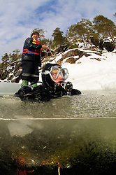 split shot from ice diving, ice diver, split level picture, Russia,  White Sea, MR