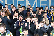 AFC Wimbledon fans shouting during the The FA Cup 5th round match between AFC Wimbledon and Millwall at the Cherry Red Records Stadium, Kingston, England on 16 February 2019.