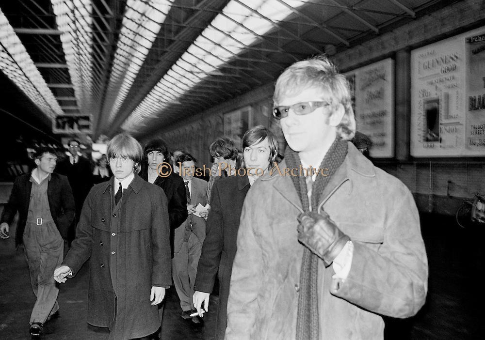 The Rolling Stones Charlie is my Darling - Ireland 1965..The Rolling Stones and manager Andrew Loog Oldham arriving at Amiens Street station (now Connolly station) for thier concert at the Adelphi Theatre, Middle Abbey Street, Dublin. This was the band's first Irish tour of 1965...The Rolling Stones Charlie is my Darling - Ireland 1965.Birthday gift ideas of a Limited Edition Prints of Andrew Loog Oldham, The Rolling Stones, Charlie is my Darling – Ireland 1965. Fine art Limited Edition Prints of Andrew Loog Oldham, The Rolling Stones, Charlie is my Darling – Ireland 1965. Unique birthday gifts for him  a Limited Edition Prints of Andrew Loog Oldham, The Rolling Stones, Charlie is my Darling – Ireland 1965.  Gifts for men of  Limited Edition Prints of Andrew Loog Oldham, The Rolling Stones, Charlie is my Darling – Ireland 1965.  Groomsmen gifts  of Limited Edition Prints of Andrew Loog Oldham, The Rolling Stones, Charlie is my Darling – Ireland 1965.  <br /> Gift ideas of Limited Edition Prints of Andrew Loog Oldham, The Rolling Stones, Charlie is my Darling – Ireland 1965.  Thank you gifts of Limited Edition Prints of Andrew Loog Oldham, The Rolling Stones, Charlie is my Darling – Ireland 1965.  <br /> Cool gifts of Limited Edition Prints of Andrew Loog Oldham, The Rolling Stones, Charlie is my Darling – Ireland 1965.  Wedding gifts  of Limited Edition Prints of Andrew Loog Oldham, The Rolling Stones, Charlie is my Darling – Ireland 1965.  <br /> Romantic gifts of Limited Edition Prints of Andrew Loog Oldham, The Rolling Stones, Charlie is my Darling – Ireland 1965.  Anniversary gifts of Limited Edition Prints of Andrew Loog Oldham, The Rolling Stones, Charlie is my Darling – Ireland 1965.  <br /> Christmas gifts of Limited Edition Prints of Andrew Loog Oldham, The Rolling Stones, Charlie is my Darling – Ireland 1965.