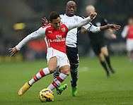 West Brom's Youssouf Mulumbu tussles with Arsenal's Alexis Sanchez<br /> <br /> Barclays Premier League- West Bromwich Albion vs Arsenal - The Hawthorns - England - 29th November 2014 - Picture David Klein/Sportimage