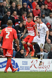 Leyton Orient's Dean Cox and Milton Keynes Dons' George Baldock compete for the ball - Photo mandatory by-line: Mitchell Gunn/JMP - Tel: Mobile: 07966 386802 12/10/2013 - SPORT - FOOTBALL - Brisbane Road - Leyton - Leyton Orient V MK Dons - League One