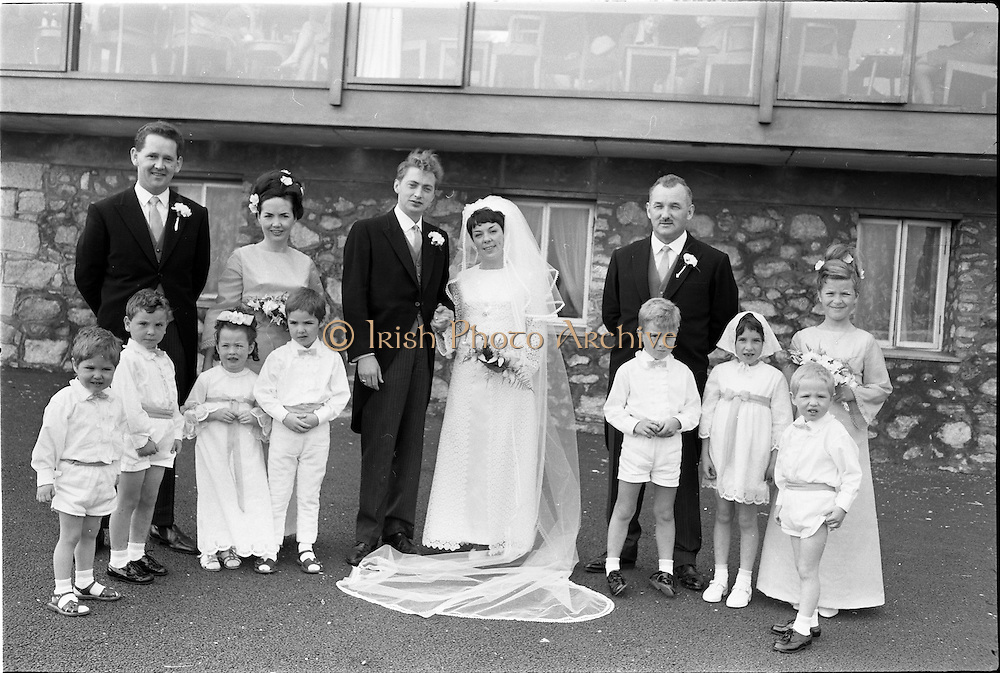 "16/09/1967<br /> 09/16/1967<br /> 16 September 1967<br /> Wedding of Mr Francis W. Moloney, 28 The Stiles Road, Clontarf and Ms Antoinette O'Carroll, ""Melrose"", Leinster Road, Rathmines at Our Lady of Refuge Church, Rathmines, with reception in Colamore Hotel, Coliemore Road, Dalkey. Image shows (l-r); Unnamed gentleman; Matron of Honour Gladys McGloughlin; the Bride and Groom; Bestman, Michael Power and unnamed Bridesmaid. In front are flower girls and pageboys."