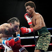 Elon de Jesus (L) fights Alexander Mancil during a One For All Promotions boxing event at the Caribe Royale Orlando Events Center on Saturday, February 20, 2021 in Orlando, Florida. (Alex Menendez via AP)