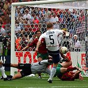 USA's John O'Brien scores their first goal against Portugal