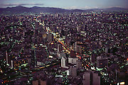 At dusk, the vast expanse of Mexico City, Mexico seen from the top of the Hotel de Mexico.