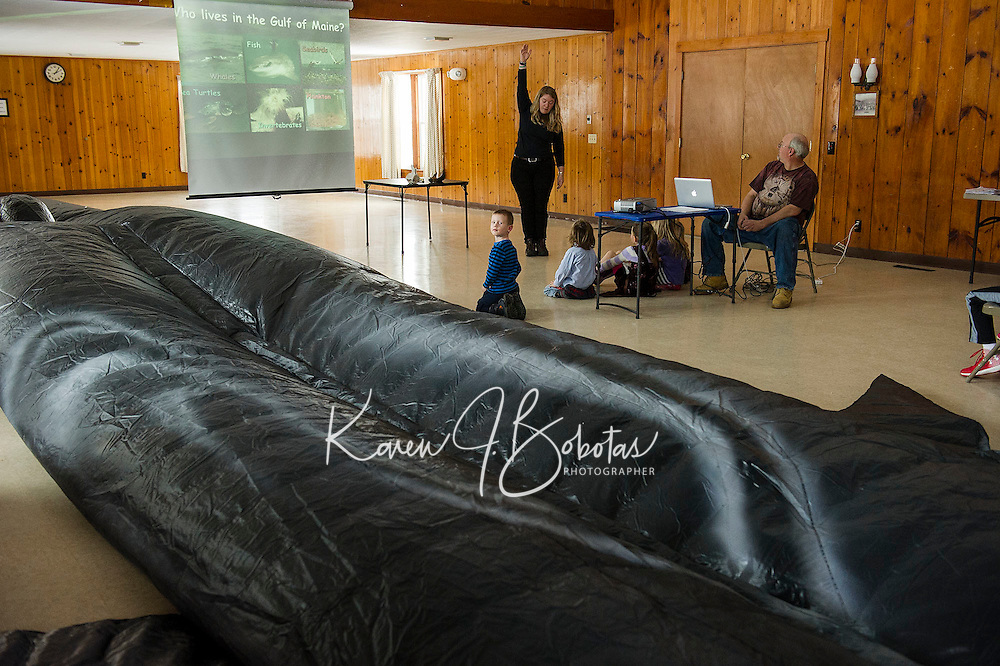 """Abby Gronberg from Blue Ocean Society for Marine Conservation talks about """"Ladder"""" a 65 foot whale during her presentation at Leavitt Park in Laconia on Sunday afternoon.  (Karen Bobotas/for the Laconia Daily Sun)"""