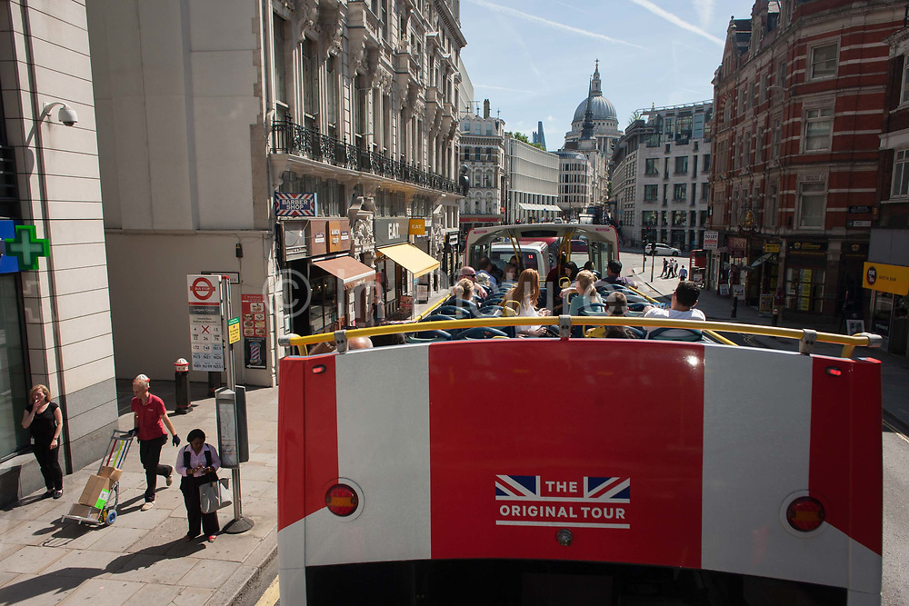 A tour bus with The Original Tour latest branding of a Union jack flag drives past the Royal Courts of Justice on Fleet Street, on 7th July 2017, in central London.