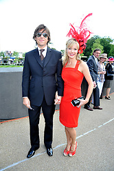 AMANDA HOLDEN and her husband CHRIS HUGHES at at the first day of the 2009 Royal Ascot racing festival on 16th June 2009.