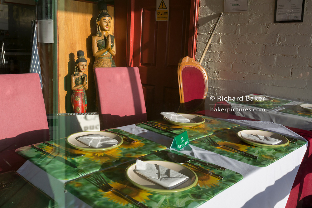 Window interior of a Thai restaurant on Ramsgate's Royal Parade, on 8th January 2019, in Ramsgate, Kent, England. The Port of Ramsgate has been identified as a 'Brexit Port' by the government of Prime Minister Theresa May, currently negotiating the UK's exit from the EU. Britain's Department of Transport has awarded to an unproven shipping company, Seaborne Freight, to provide run roll-on roll-off ferry services to the road haulage industry between Ostend and the Kent port - in the event of more likely No Deal Brexit. In the EU referendum of 2016, people in Kent voted strongly in favour of leaving the European Union with 59% voting to leave and 41% to remain.