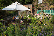 "Sitting in the cafe garden at The Brew House, Kenwood House. Hampstead Heath (locally known as ""the Heath"") is a large, ancient London park, covering 320 hectares (790 acres). This grassy public space is one of the highest points in London, running from Hampstead to Highgate. The Heath is rambling and hilly, embracing ponds, recent and ancient woodlands."