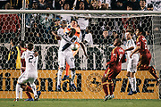 Real Salt Lake goalkeeper Nick Rimando, right, punches the ball away from Los Angeles Galaxy forward Edson Buddle during the first half of an MLS soccer match, Saturday, March 10, 2012, in Carson, Calif. Real Salt Lake won 3-1. (AP Photo/Bret Hartman)