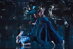 "© Licensed to London News Pictures. 12/05/2015. London, England. Pictured: Miguel Altunaga and Carolyn Bolton. Rambert Dance Company perform the World Premiere of ""Dark Arteries"" by Mark Baldwin as part of a triple bill at Sadler's Wells Theatre. Rambert perform with the Tredegar Town Band and the Rambert Orchestra from 12 to 16 May 2015. Photo credit: Bettina Strenske/LNP"