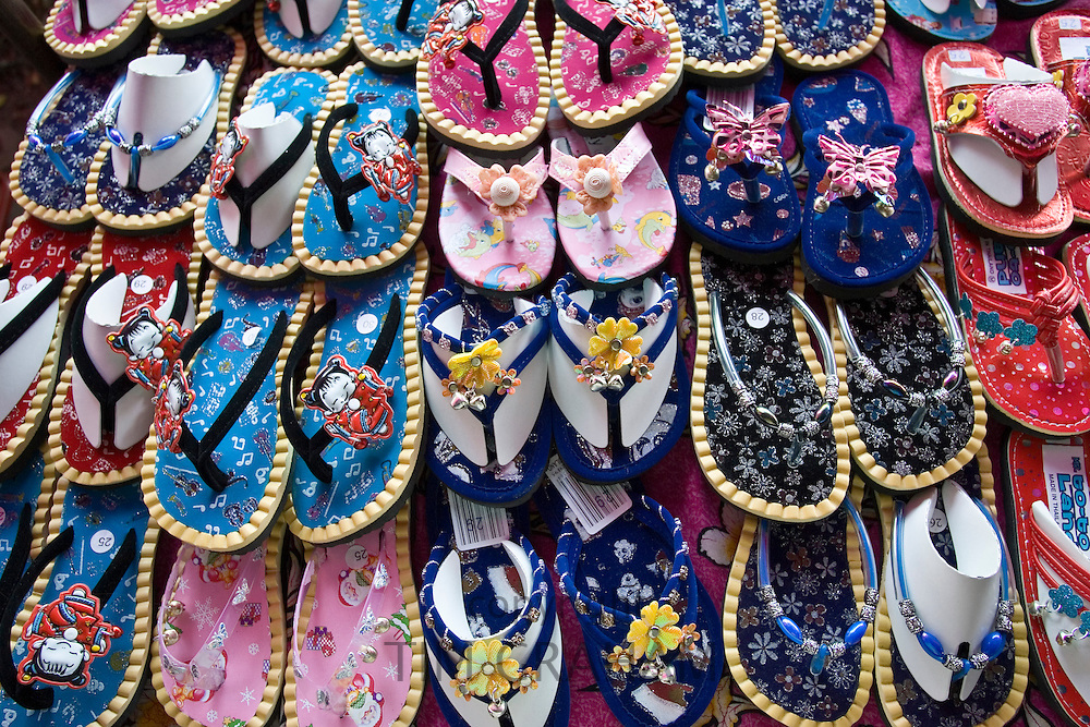 Shoes for sale on a market in Bangkok, Thailand