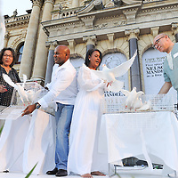 The Executive Mayor of Cape Town, PATRICIA DE LILLE, former springbok rugby player, CHESTER WILLIAMS, singer VICKY SAMPSON and Minister in the Presidency, TREVOR MANUEL, release doves in remembrance of Nelson Mandela.The City of Cape Town hosted an interfaith service on the Grand Parade as the day was declared a national day of prayer and reflection on the life of Nelson Mandela. Visitors also placed flowers and condolence messages on the barricade erected to accommodate it. Various religious leaders said prayers for the late South African President