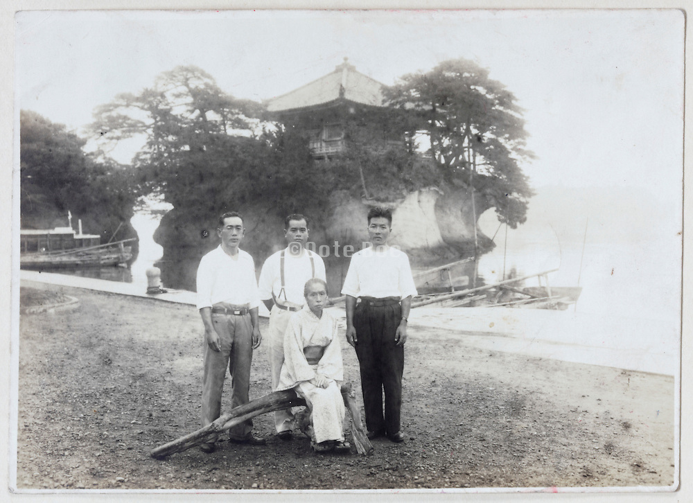 during a trip in front of a temple Japan late 1940s