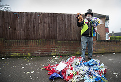 © Licensed to London News Pictures. 11/04/2018. London, UK. A man who gave his name as Iain Gordon holds flowers and a teddy bear left in tribute to burglar Henry Vincent after removing all the floral tributes from near the house of Richard Osborn-Brooks. Henry Vincent was killed as he burgled the home of 78 year old Richard Osborn-Brooks. Mr Osborn-Brooks was arrested for murder but later released without charge. Friends and family of Henry Vincent have had floral tributes they placed near the scene repeatedly torn down by locals. Photo credit: Peter Macdiarmid/LNP