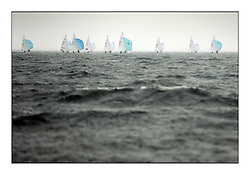470 Class European Championships Largs - Day 1.Racing in grey and variable conditions on the Clyde..Heavy Rain during the second race.