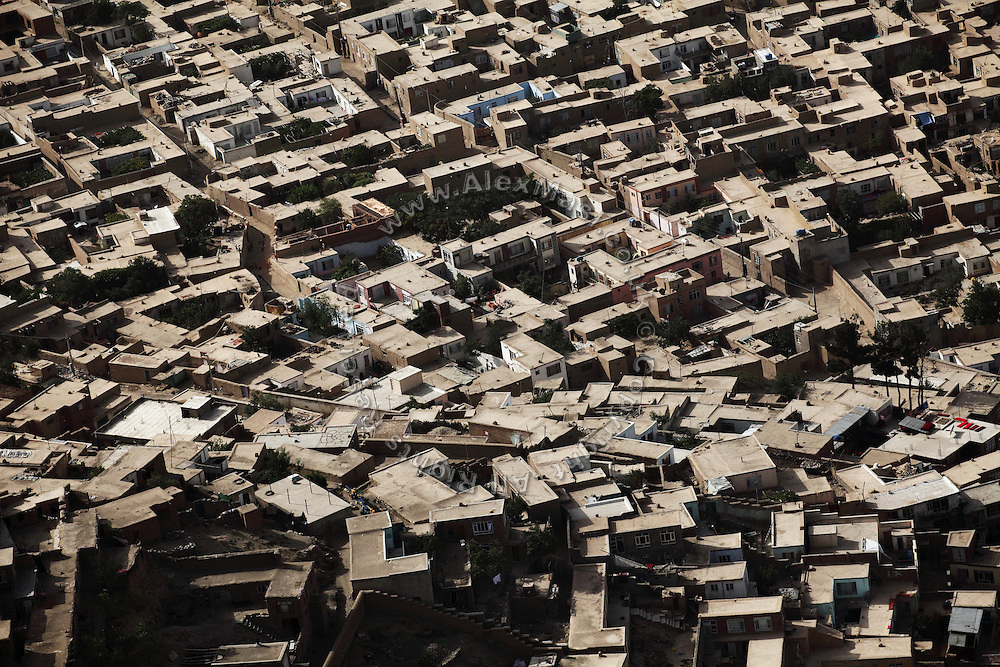 A section of the city of Kabul, the capital of Afghanistan, is photographed from a helicopter flying above the city.