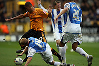 Photo: Rich Eaton.<br /> <br /> Wolverhampton Wanderers v Sheffield Wednesday. Coca Cola Championship. 28/10/2006. Leon Clarke #17 scorer of the first goal of the game for Wolves gets tackled by  John Hills of Wednesday