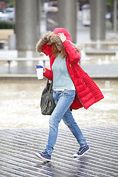 © Licensed to London News Pictures. 05/05/2015. Bristol, Avon, UK. A woman walking in the rain in Bristol this morning, 5th May 2015. Rain showers and strong, blustery winds have been sweeping up the South West of England, with brighter, but still windy weather expected later. Photo credit : Rob Arnold/LNP