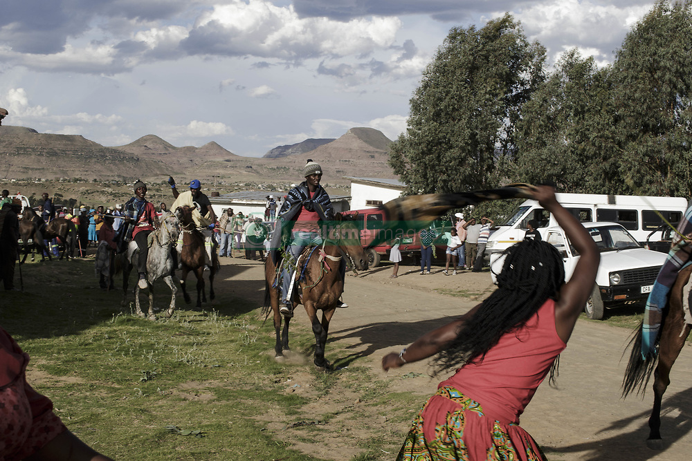 December 29, 2017 - Matatiele, Eastern Cape, South Africa - Xhosa people wait for the initiates to return from the mountains. Women and horse riders hit each other with sticks and textiles. (Credit Image: © Stefan Kleinowitz/zReportage.com/ZUMA Wire)