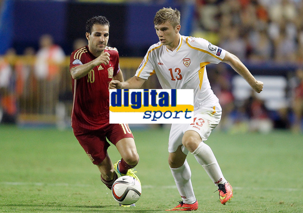 Spain's Cesc Fabregas (l) and Fyrom's Stefan Ristovski during 15th UEFA European Championship Qualifying Round match. September 8,2014.(ALTERPHOTOS/Acero)