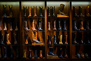 NASHVILLE, Tenn. - Rows of cowboy boots sit out on display at Lucchese Bootmaker in The Gulch in Nashville.