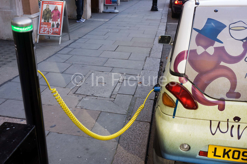 A power cable plugs into the place of a petrol cap while recharging an electronic Daimler-Chrysler-made Smart car. The car is parked at the kefrbside of Southampton Street near London's Covent Garden and is hooked up to a recharging point. A charging station, also called electric recharging point, charging point and EVSE (Electric Vehicle Supply Equipment) supplies electricity for the recharging of electric vehicles (including plug-in hybrids). Although most electric cars can be recharged from a domestic wall socket, many support faster charging at higher voltages and currents that require dedicated equipment with a specialized connector.