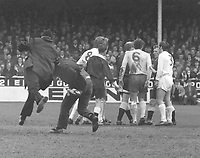 Football - 1970 - 1971 Leeds United v West Bromwich Albion at Elland road, 17/04/1971.<br /> <br /> Crowd trouble gets out of control as a Policeman grabs an angry Leeds supporters after referee,Mr Ray Tinkler, after he awarded the controversial  goal by Jeff Astle (WBA) that they felt was offside. It was to prove costly as they lost the League Championship title to Derby County by one point.<br /> Tinkler talks with both linesman with players John Wile and Terry Cooper of Leeds<br /> <br /> John Wile of WBA (6) and Terry Cooper (3) of Leeds talk to the referee and his officials<br /> <br /> The ugly events that happen after the goal, forced the Football Association to fine the club and make them play their first 4 home games at the start of next season,away at other grounds ( 2 at Huddersfield, 1 at Hull and 1 at Sheffield Wednesday.<br /> <br /> Credit Colorsport.
