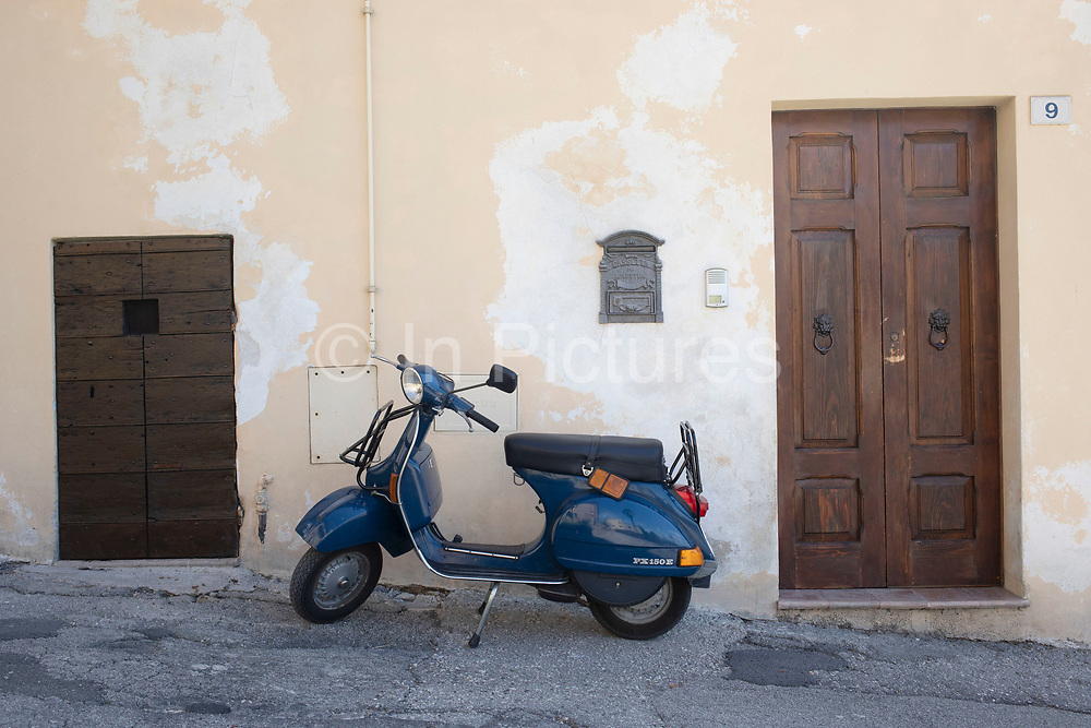 Vespa PX150E motor scooter in Bevagna, Umbria, Italy. The Vespa PX Series is a range of scooters manufactured by Piaggio under the Vespa brand.