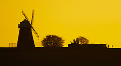 © Licensed to London News Pictures. 26/02/2019. Chichester, UK. People walk towards the Halnaker Windmill near Chichester, West Sussex at first light ahead of another day of unseasonably high winter temperatures. Photo credit: Peter Macdiarmid/LNP