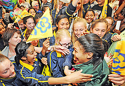 Cape Town - 140831 - Pictured are La Rochelle Girls' High School pupils welcoming Gezelle Magerman. Gezelle Magerman received a hero's welcome at the Cape Town International Airport. She won South Africa's first medal of the 2014 Youth Olympic Games, taking gold in the women's 400m hurdles in Nanjing, China. Reporter: Kieran Legg Picture: David Ritchie (083 652 4951)