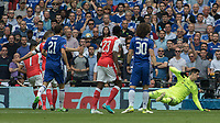 Football - 2017 FA Cup Final - Arsenal vs. Chelsea<br /> <br /> Alexis Sanchez of Arsenal turns away after beating Thibaut Courtois of Chelsea at Wembley.<br /> <br /> COLORSPORT/DANIEL BEARHAM