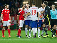 Football - 2016 / 2017 World Cup Qualifier - Group D: Wales vs. Serbia<br /> <br /> Ashley Williams, captain of Wales confronts Vladimir Stoijkovic of Serbia, at Cardiff City Stadium.<br /> <br /> COLORSPORT/WINSTON BYNORTH
