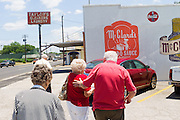 HOT SPRINGS, AR – JUNE 28, 2013: Elderly customers walk to their vehicle after lunch at McClard's BAR-B-Q, a local joint known for its barbecue ribs, pork and signature tamales.<br /> <br /> McClard's has been family owned and operated since 1928, and the business is now in its fourth generation run by Scott McClard. The restaurant is renowned for maintaining its original recipes from the 1920s throughout the generations, and each week 7,000 pounds of beef, pork and ribs are sold at McClard's. The restaurant moved to it's current  location on Albert Pike in the 1940s.